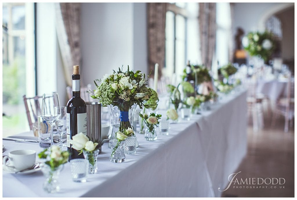 Top table display using wedding bouquets